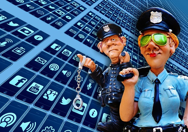 police figures in front of social media icons