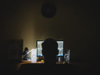 hacker sat at computer screen